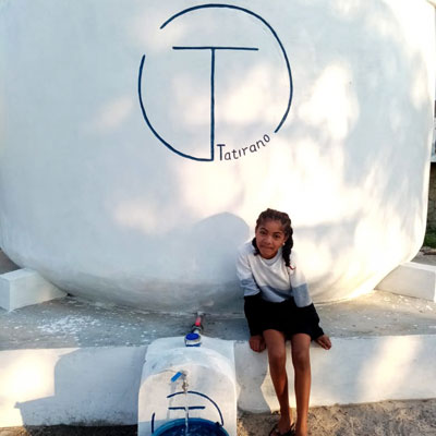 Finished Tatirano tank with water point and smiling girl